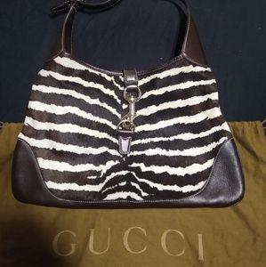 Authentic Gucci zebra/chocolate leather